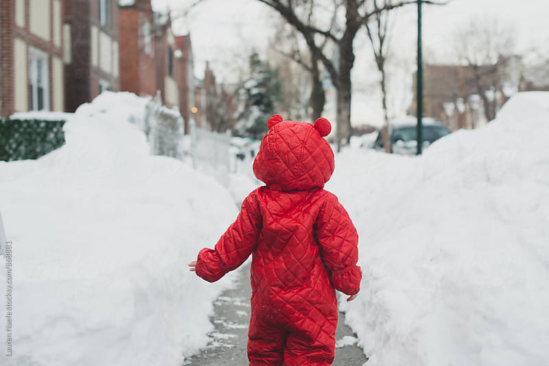 Toddler running in the snow by Lauren Naefe for Stocksy United