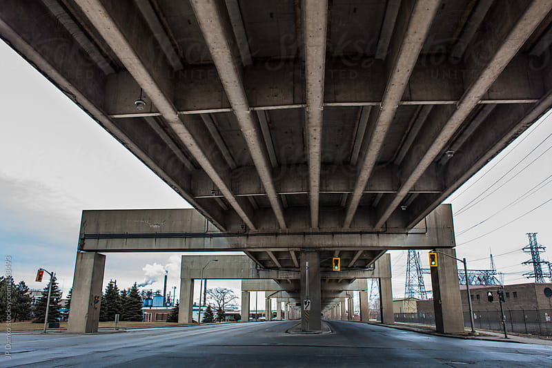Industrial Highway In Gritty Urban Area With Overpass Bridge by JP Danko for Stocksy United