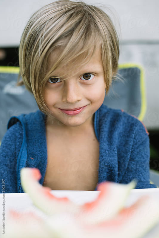 Portrait Of A Cute Looking Young Boy With Long Blonde Hair