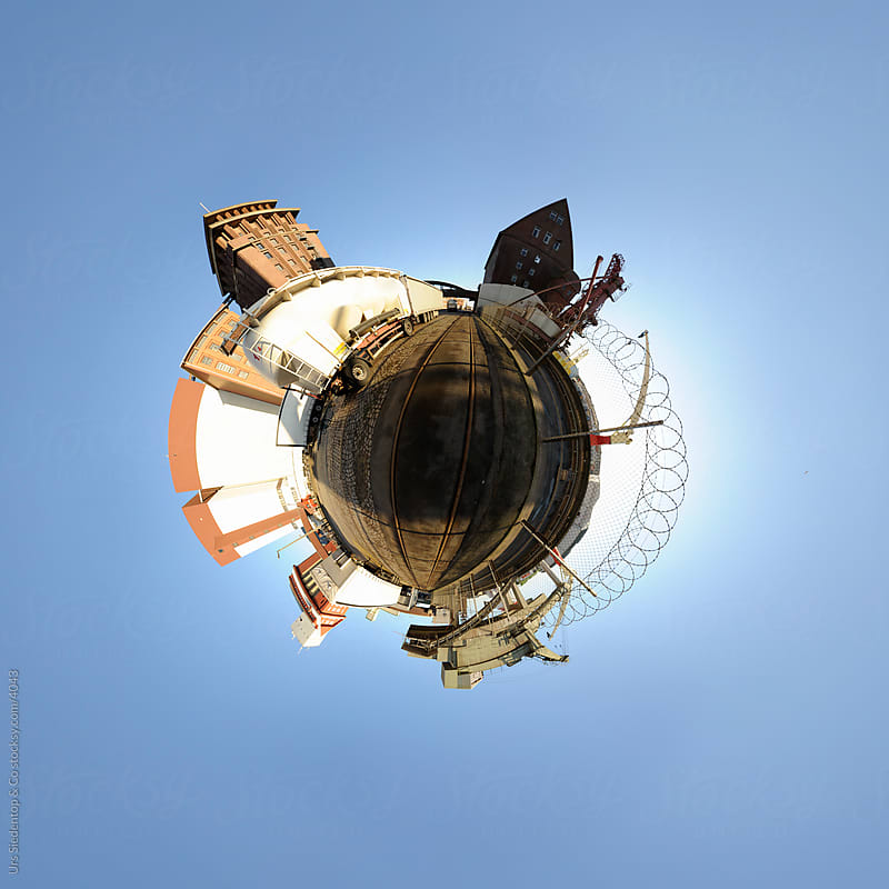 Little planet spherical panorama of  harbour and industry buildings by Urs Siedentop & Co for Stocksy United