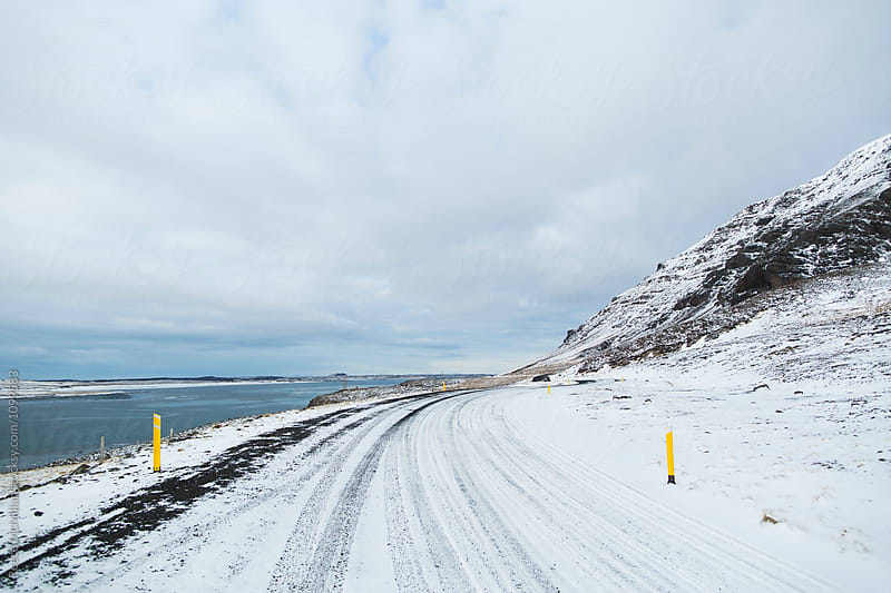 Snow covered road in Iceland by Reece McMillan for Stocksy United