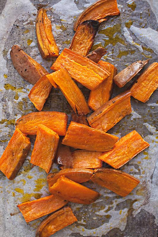 roasted sweet potato wedges by Natalie JEFFCOTT for Stocksy United