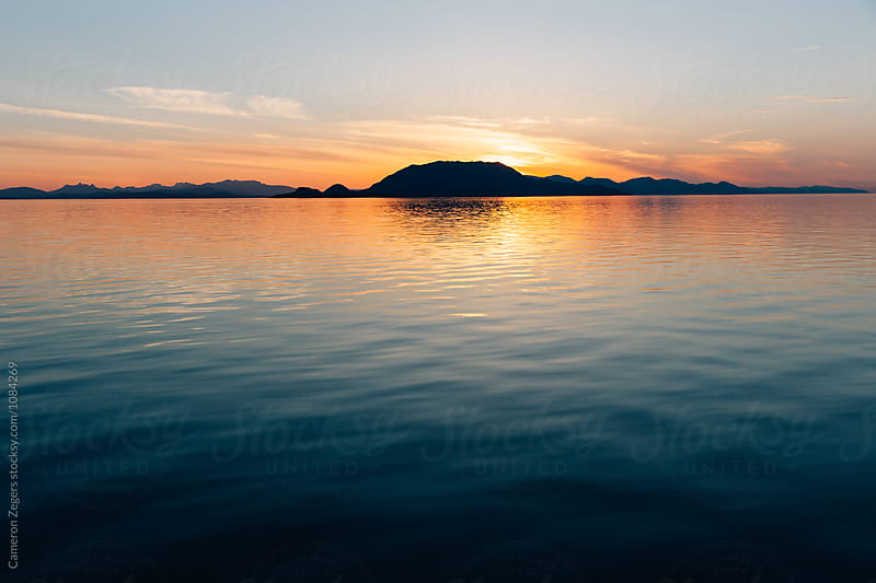 sunset near Ketchikan, Alaska by Cameron Zegers for Stocksy United