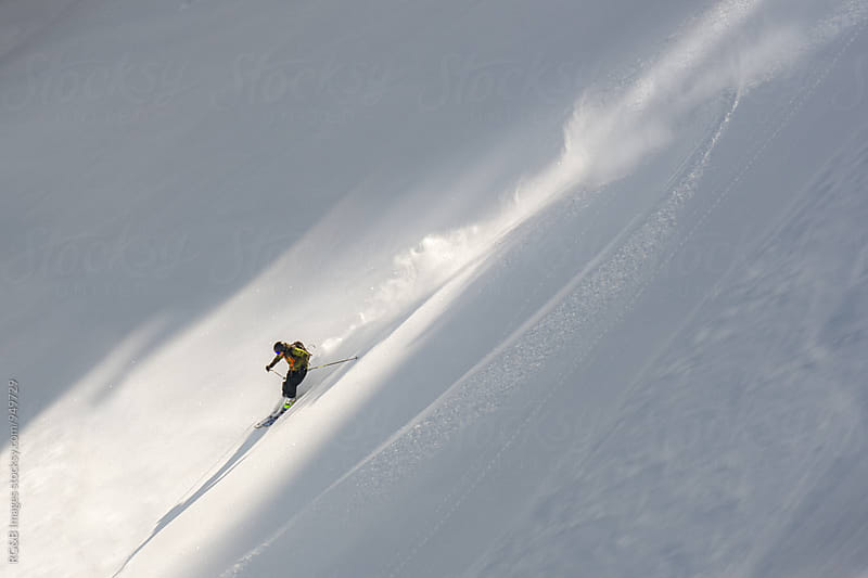 Free skier skiing fast on a path of light by RG&B Images for Stocksy United