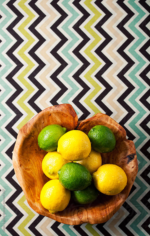 Food: Wooden Bowl of Lemons and Limes by Sean Locke for Stocksy United