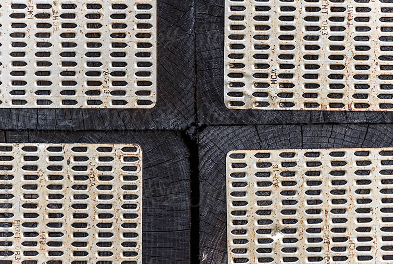 Close up of railway ties or sleepers in a train yard by Deirdre Malfatto for Stocksy United