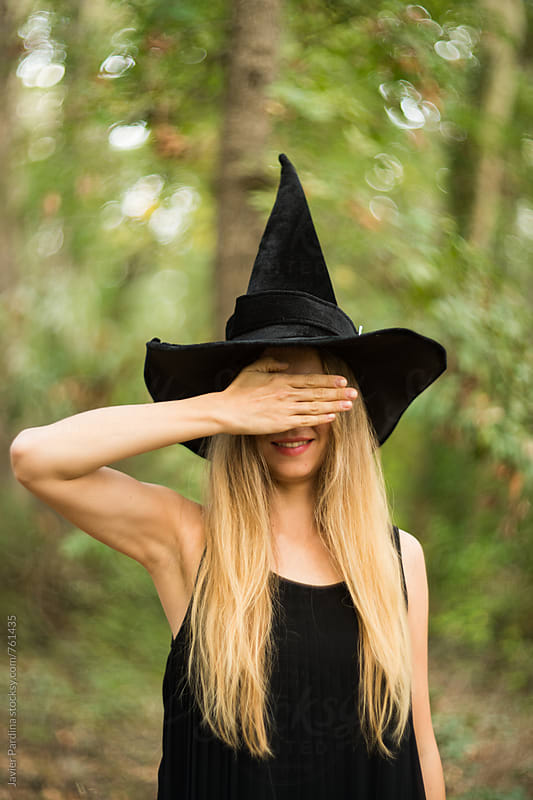 blonde girl in a witch costume by Javier Pardina for Stocksy United