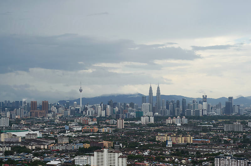 Aerial view to Kuala Lumpur by Alice Nerr for Stocksy United