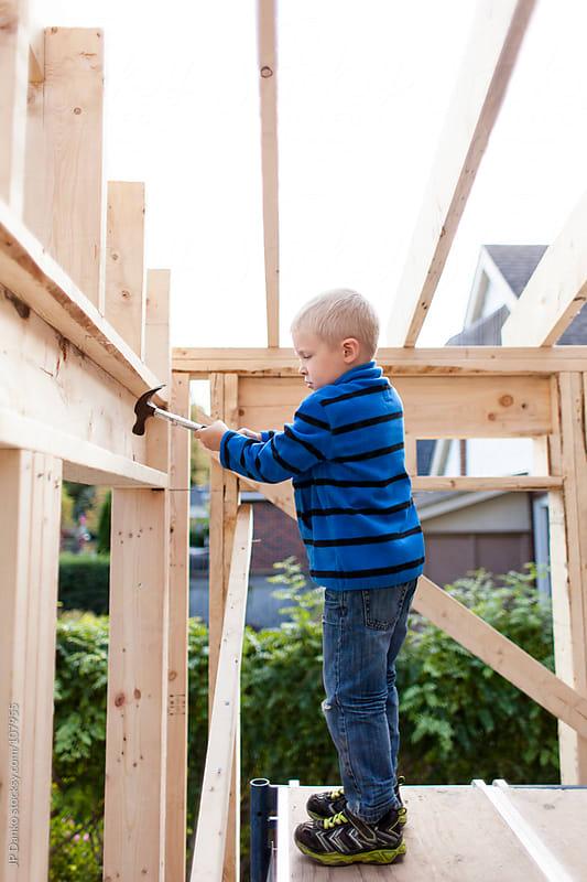 Little Boy Training for Job as Carpenter by JP Danko for Stocksy United
