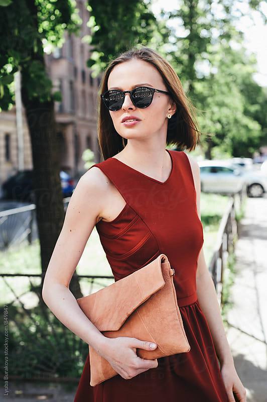 Woman wearing sunglasses by Lyuba Burakova for Stocksy United