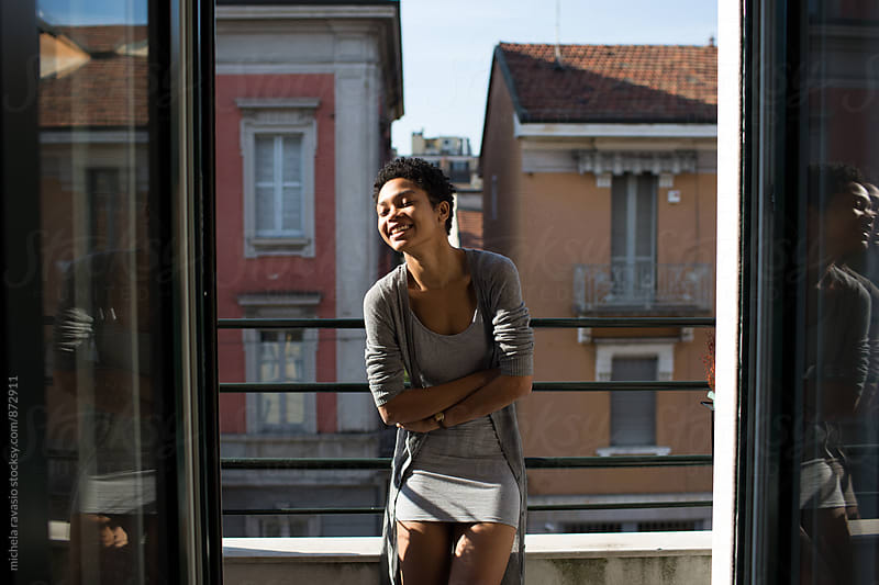 Happy girl relaxing on the balcony by michela ravasio for Stocksy United