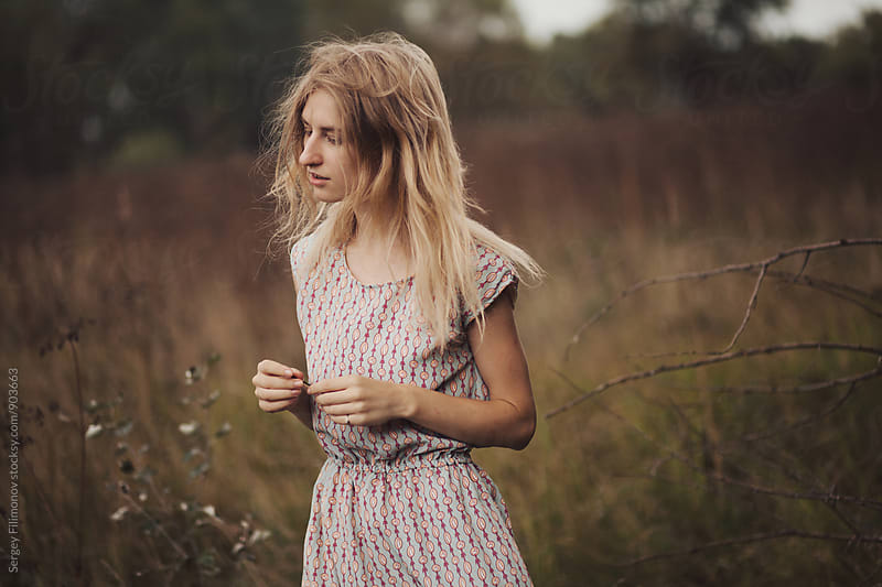 Portrait of young female walking in autumn field by Sergey Filimonov for Stocksy United