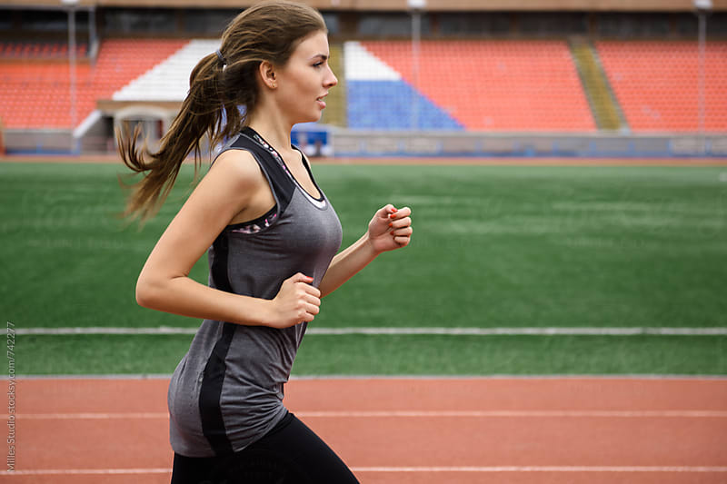 Woman running outdoors by Milles Studio for Stocksy United