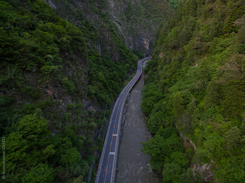 aerial view of road in the mountain  by Bo Bo for Stocksy United