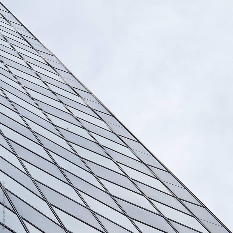 facade with many windows and sky by Melanie Kintz for Stocksy United