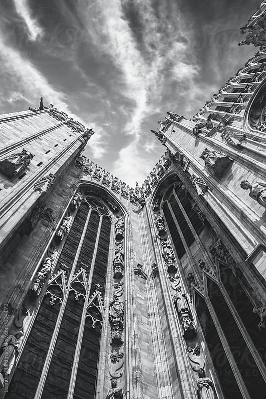 dramatic sky scenery at the Duomo in Milan  by Leander Nardin for Stocksy United