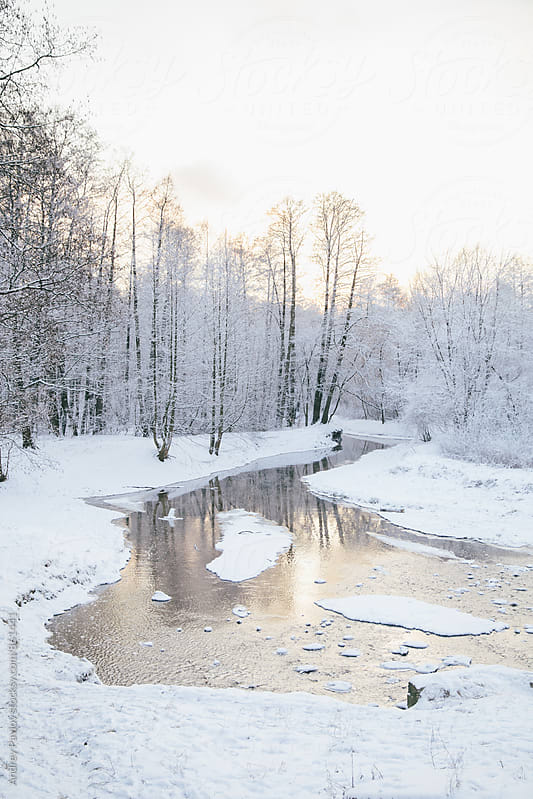 Winter landcape of snowy river by Andrey Pavlov for Stocksy United
