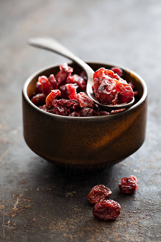 Dried Cranberries in a bowl by Corinna Gissemann for Stocksy United