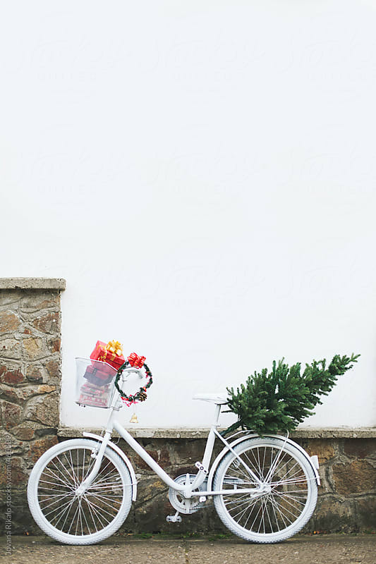Christmas tree,gifts and wreath on a white bicycle by Jovana Rikalo for Stocksy United