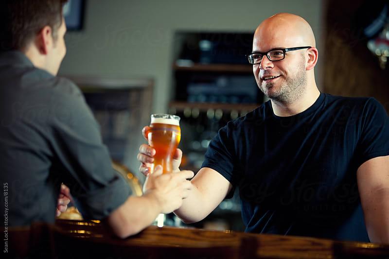 Bar: Customer Purchasing a Beer by Sean Locke for Stocksy United