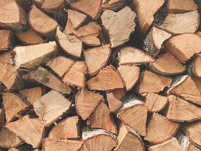 Stack of cut firewood by Paul Edmondson for Stocksy United