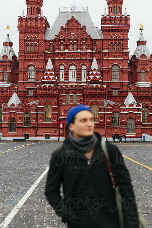 Man standing in front of Historical Museum at Red Square by Andrey Pavlov for Stocksy United