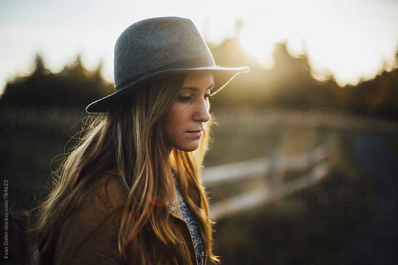 Young Blonde Woman In Hat by Evan Dalen for Stocksy United