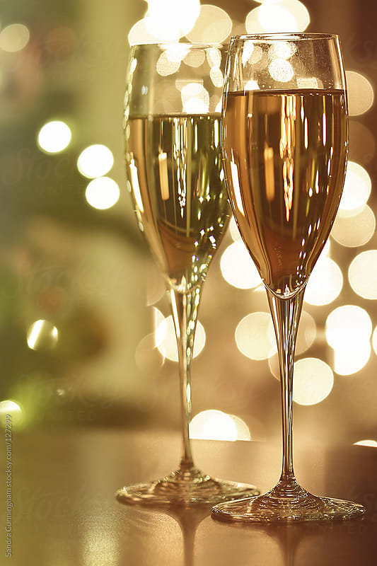 Two glasses of champagne for the holidays by Sandra Cunningham for Stocksy United