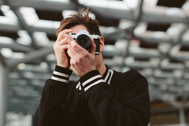 Creative man taking a photo  by Denni Van Huis for Stocksy United