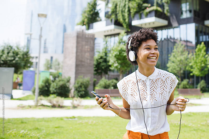 Happy young woman listening to her favorite music by michela ravasio for Stocksy United