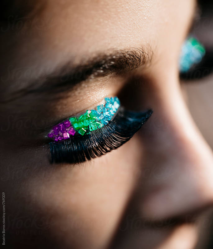 Rainbow make-up closeup on eyes by Beatrix Boros for Stocksy United