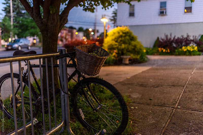bicycle parked in a village at night by Deirdre Malfatto for Stocksy United