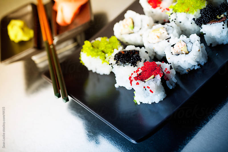 Food: Colorful Sushi Rolls with Accompaniments by Sean Locke for Stocksy United