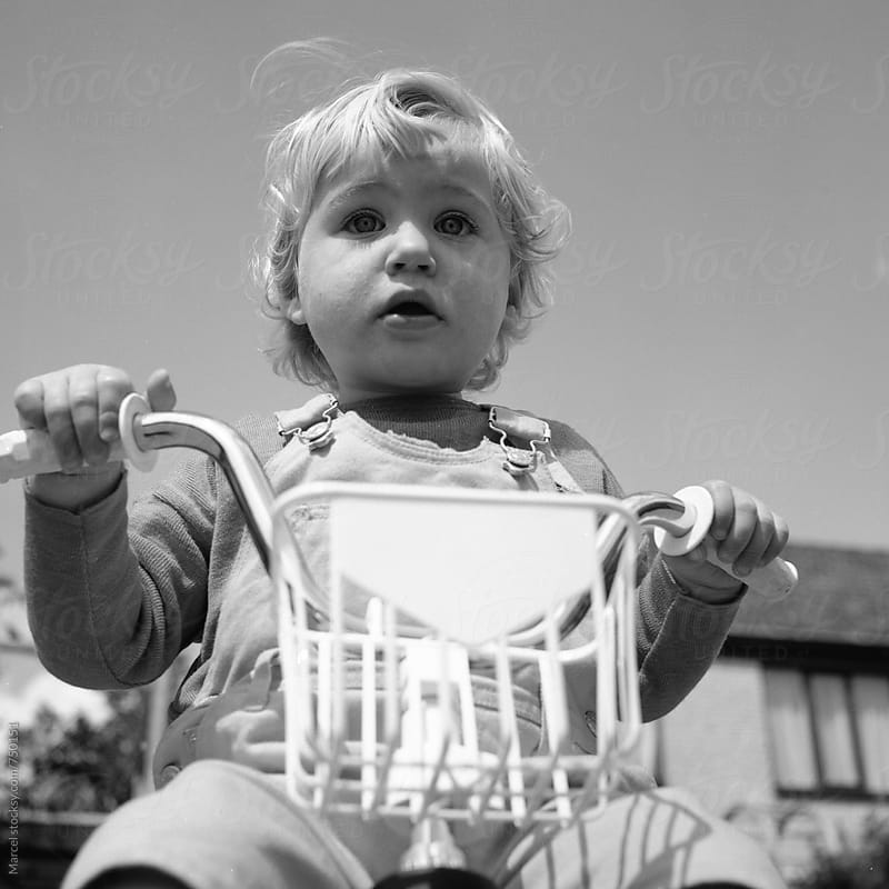 Cute toddler girl on her first bicycle by Marcel for Stocksy United