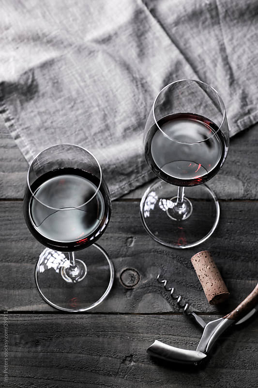 Wine: Two glasses of red wine and corkscrew by Ina Peters for Stocksy United