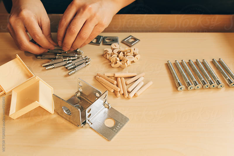 Closeup View of Woman Hands Assembling Wooden Furniture at Home by VICTOR TORRES for Stocksy United