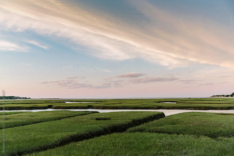 Sunset over Marsh  by Raymond Forbes LLC for Stocksy United