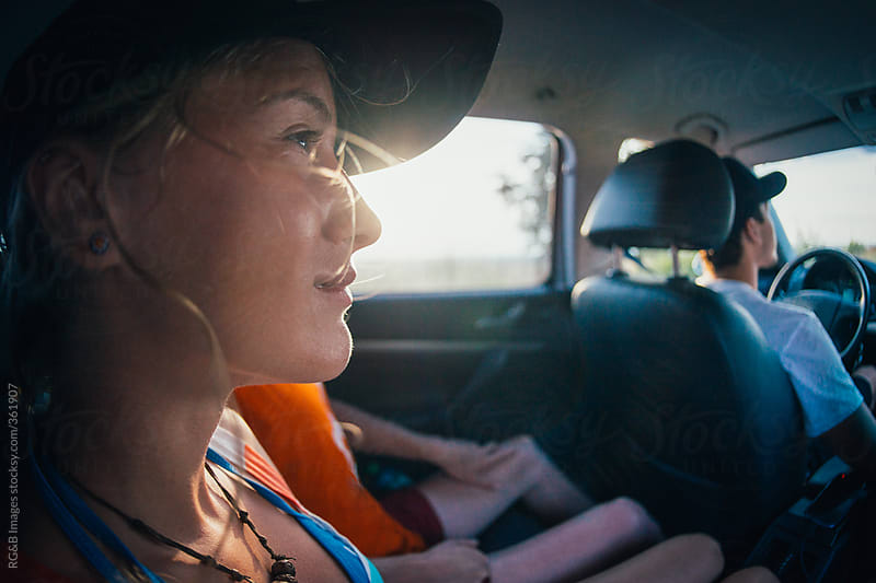 girl travelling inside a car by RG&B Images for Stocksy United