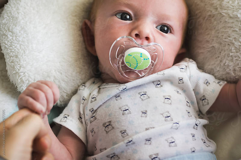 Newborn baby boy with a pacifier by yuko hirao for Stocksy United