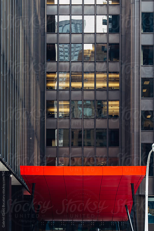Red awning on a modern architecture building by Gabriel (Gabi) Bucataru for Stocksy United