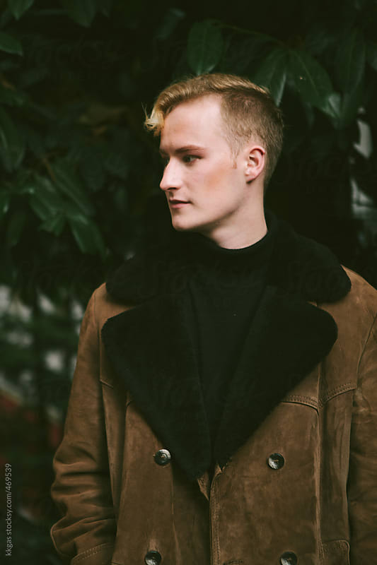 stylish blonde man wearing sheepskin coat in Paris by kkgas for Stocksy United