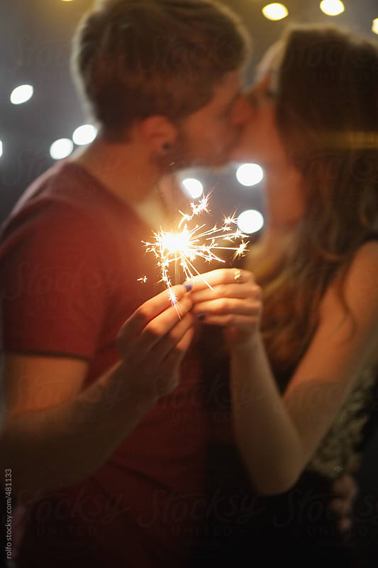 couple kiss sparkler by rolfo for Stocksy United