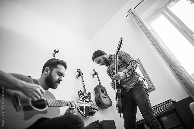 Guitarists jamming at home by Silvia Cipriani for Stocksy United