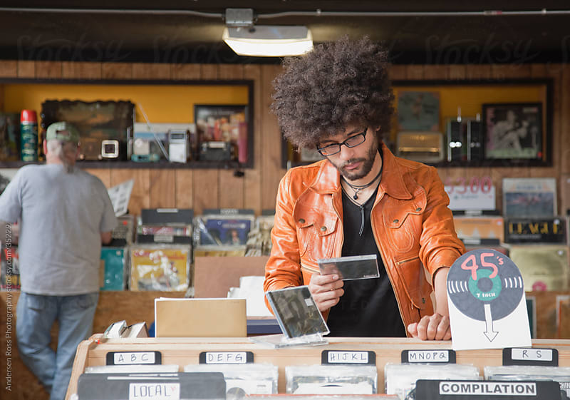 Young man in record shop by Andersen Ross Photography for Stocksy United