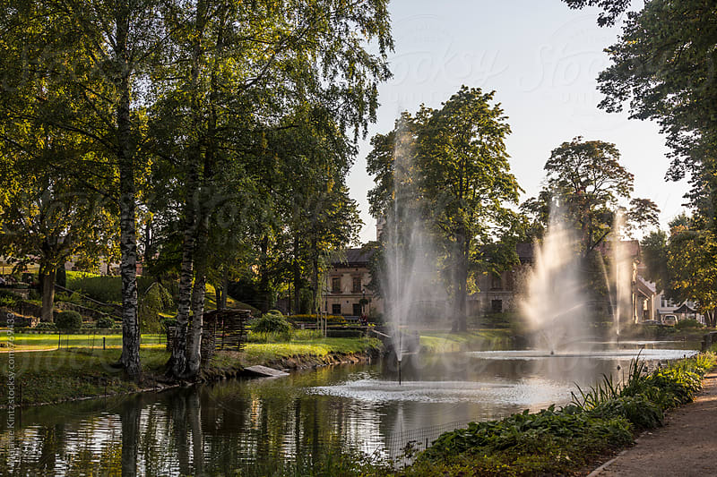 Latvia, Cesis - Town park in evening light by Melanie Kintz for Stocksy United
