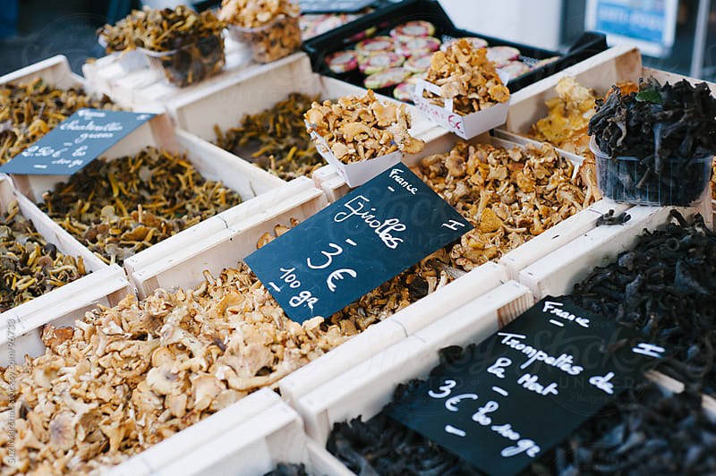 Fresh mushrooms for sale at a street market in France by Suzi Marshall for Stocksy United