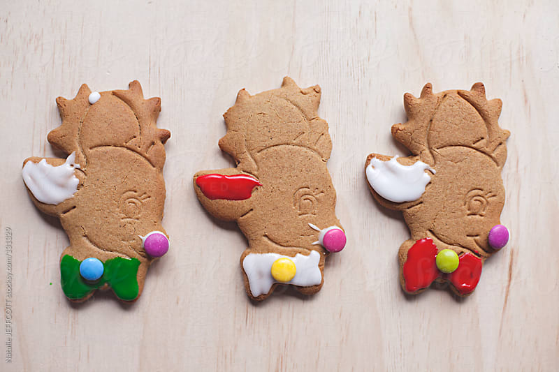 Colourful iced reindeer gingerbread cookies ready for Christmas by Natalie JEFFCOTT for Stocksy United