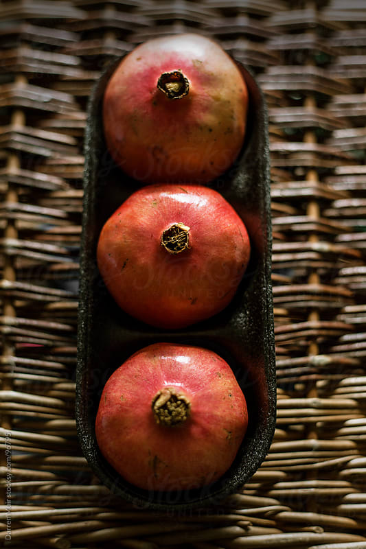 Pomegranate fruit by Darren Muir for Stocksy United