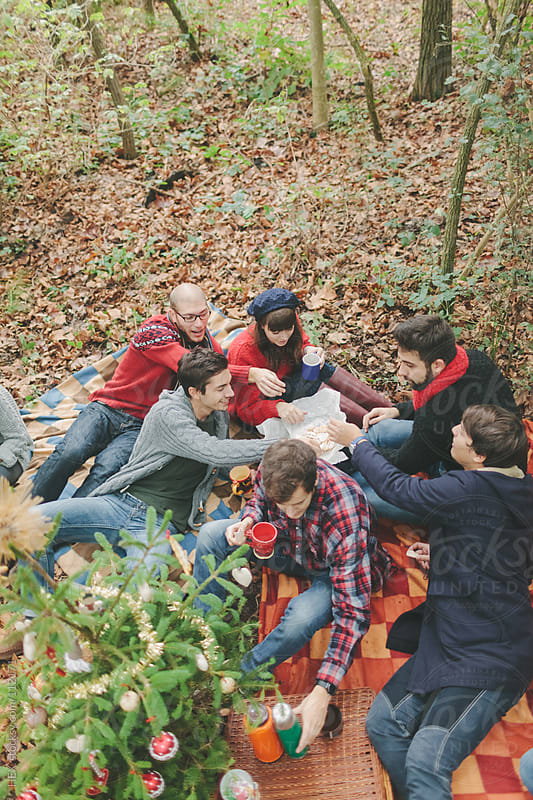 Friends During Christmas Picnic  by HEX. for Stocksy United