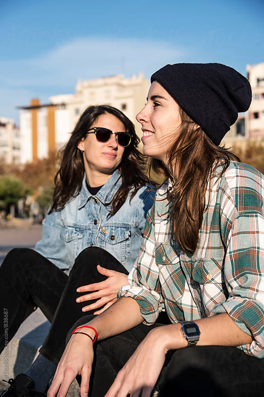 Two young skater girls taking a break in the port o Barcelona by Bisual Studio for Stocksy United